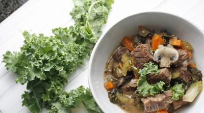 2B Mindset Instant Pot Beef Stew Overhead View of a Bowl of Stew with Fresh Kale Next to it