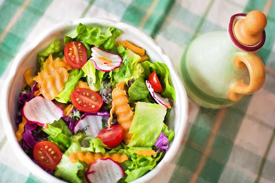 Red Wine Vinegar Salad Dressing Recipes Overhead View of a Bowl Filled with Salad on a Plaid Cloth