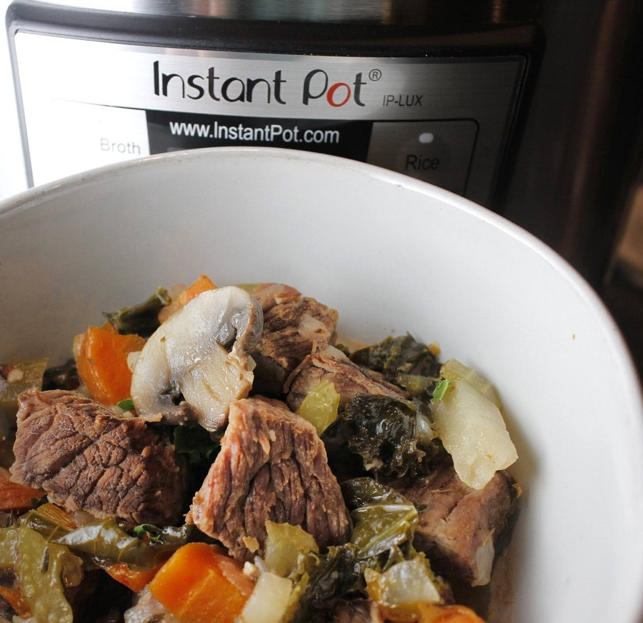 2B Mindset Instant Pot Beef Stew White Bowl of Stew in Front of an Instant Pot