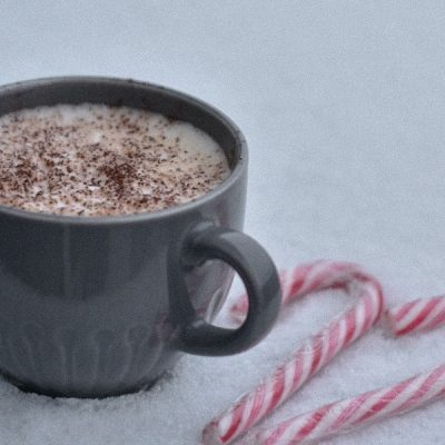 Slow Cooker Spiked Peppermint Hot Chocolate Recipes a Cup of Hot Chocolate in the Snow with Candy Canes Next to it