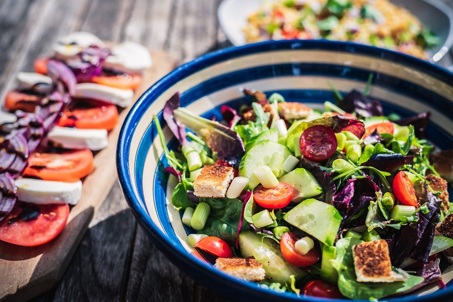 2B Mindset Recipes a Bowl of Salad with Sliced Veggies Nearby