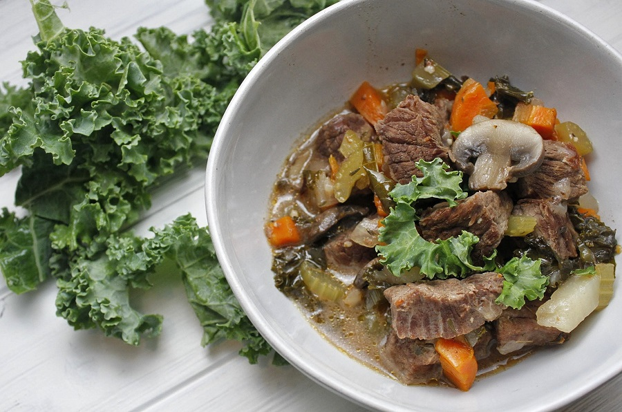Instant Pot Low Carb Beef Stew in a Bowl with Kale Next to it