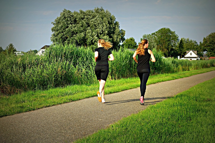 Hybrid Calendars for LIIFT4 Workouts Two Women Running