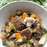 Instant Pot Low Carb Beef Stew Kale with a Bowl of Stew On Top of it