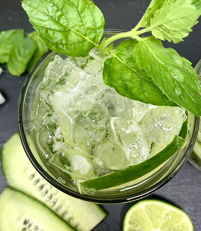 Sparkling Cucumber Cooler with Gin Cocktail Recipe Overhead View of a Glass with Mint Leaves at the Top