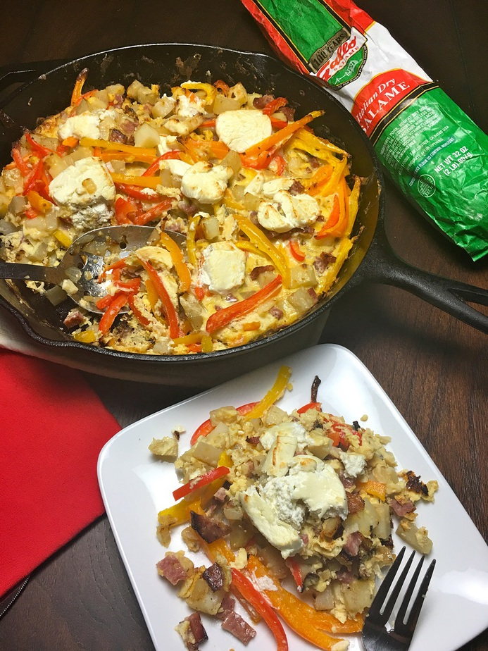 Breakfast Frittata Recipe with Potatoes Angled View of a Frittata in a Cast Iron Skillet with a Plate of Frittata Next to it